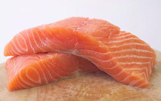 Cooked salmon is a great source of omega-3 fatty oils for your dog